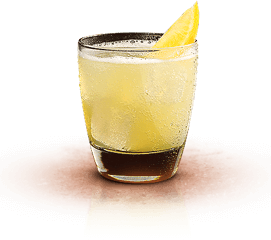 alt-yellow cocktail with a slice of lime